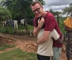 Ex-journalist meets African child whose schooling he sponsors