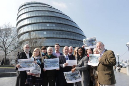 Guardian reporter Pippa Allen-Kinross, second from left, and news editor Becky Middleton, third from left at the back, with members of the Friends of Wimbledon Town Centre, deputy Mayor of London Roger Evans, centre, and Councillor David Dean, centre back