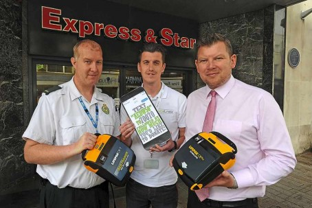 Paramedic Lee Farley, left, with fundraiser Jamie Richards and Express & Star editor Keith Harrison outside the Express & Star's offices