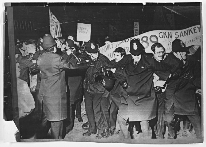 One of the photos from 1981, showing police battling to hold back 500 angry protestors when Employment Minister Jim Prior visited job-starved Telford