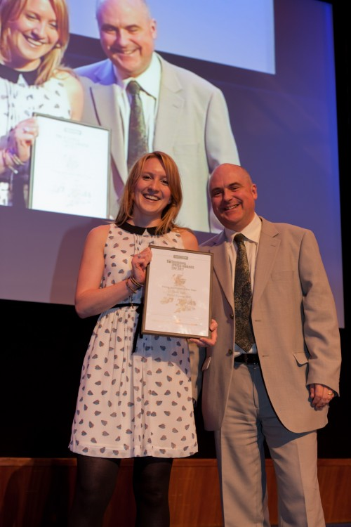 Emily Koch receives her award from HTFP publisher Paul Linford in 2012.