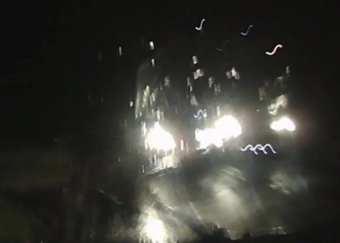 A still from Tom's dashcam footage shows the near-miss between himself and the overtaking car, the headlights of which can be seen on the left