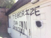 The graffiti which was daubed on the mosque