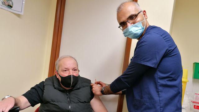 Julian Makey receives the jab from Dr Urjit Soni